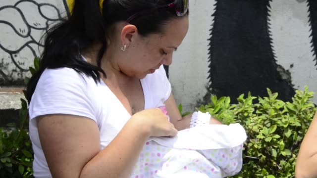 women hold a mamaton outside the legislative assembly in san jose on wednesday to protest the recent dismissal of a secretary who was breastfeeding... - legislator stock videos & royalty-free footage