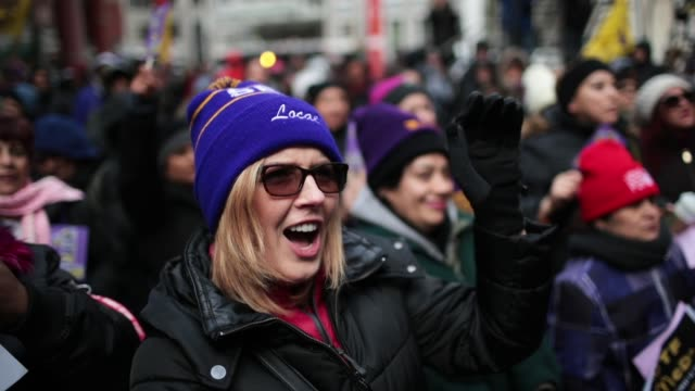 Women hold a rally to celebrate International Women's Day on March 8 2018 in Chicago Illinois International Women's Day is an annual event held to...