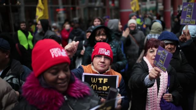 women hold a rally to celebrate international women's day on march 8 2018 in chicago illinois international women's day is an annual event held to... - uguaglianza video stock e b–roll