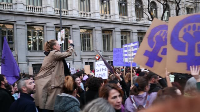 women hold placards during a protest on international women's day on march 08 2020 in madrid spain spain celebrates international women's day today... - 国際女性デー点の映像素材/bロール