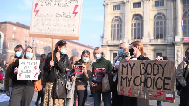 """women hold up placards during a protest over anti-abortion laws on october 31 in turin, italy. five hundred people including members of the """"non una... - women's rights stock videos & royalty-free footage"""