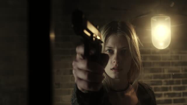 women holding a gun - arma da fuoco video stock e b–roll