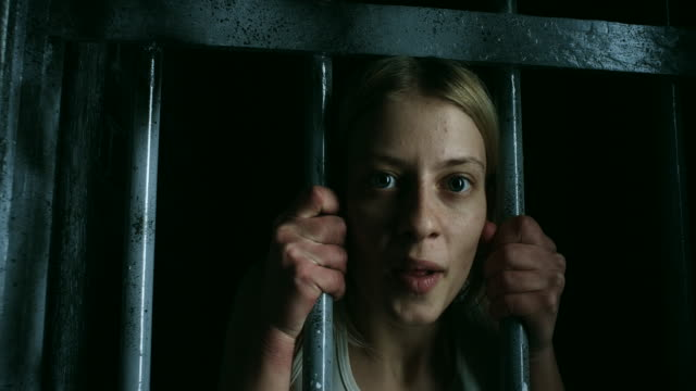 women holding bars and looking through - claustrophobia stock videos and b-roll footage