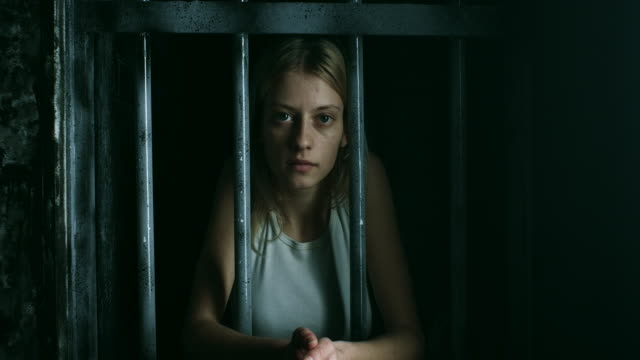 women holding bars and looking through - female prisoner stock videos & royalty-free footage