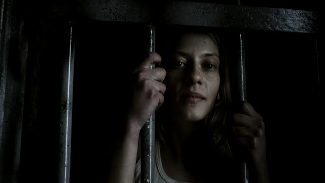 women holding bars and looking through - cell stock videos & royalty-free footage