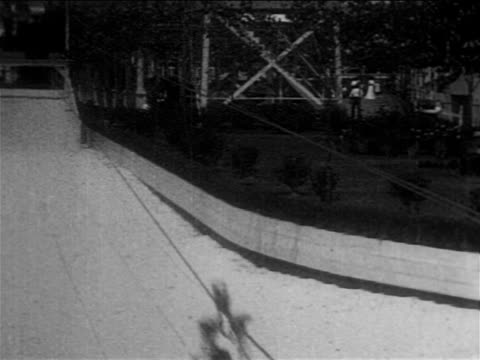 b/w 1905 women holding onto swing in high-wire amusement park ride / coney island / documentary - coney island brooklyn stock videos & royalty-free footage