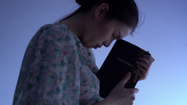 women holding the bible and crosses of blessing from god - bible stock videos & royalty-free footage