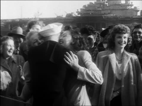 b/w 1945 2 women hugging sailor / younger one kisses him / ww ii homecoming / documentary - mature couple stock videos & royalty-free footage