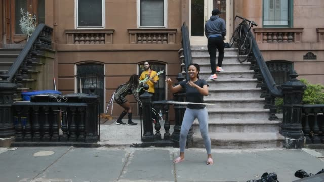 women hula hoop as people dance on their stoop at 7:00 pm to honor frontline medical workers during the coronavirus pandemic on may 12, 2020 in the... - doorstep stock videos & royalty-free footage