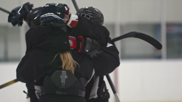 women ice hockey players hugging and celebrating - hockey glove stock videos & royalty-free footage