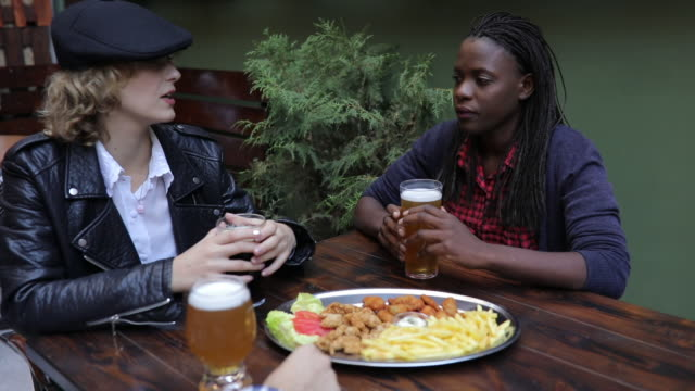 women in a bar - leather jacket stock videos & royalty-free footage