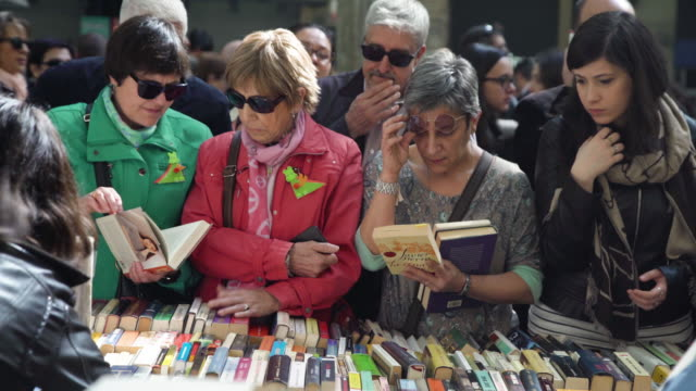 Women in a book street market at Barcelona on Sant Jordi world book day