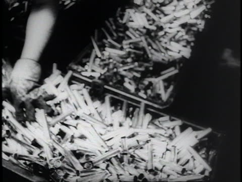 women in a factory run machines that produce cartridge cases for the war. - cartridge stock videos & royalty-free footage