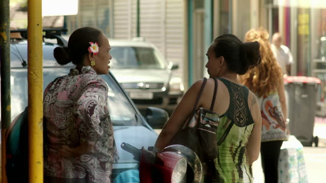 women in a street on tahiti, french polynesia - french polynesia stock videos & royalty-free footage