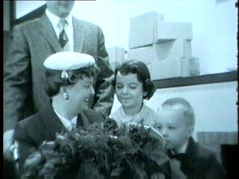 a women in a wheelchair with her children receives the march of dimes mother of the year award in 1959 - 1959 stock videos & royalty-free footage