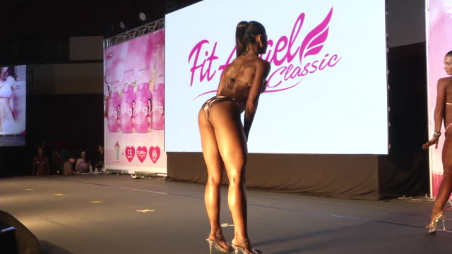women in bikinis pose on stage during the fit angel classic bodybuilding competition in bangkok thailand - muscular build stock videos & royalty-free footage