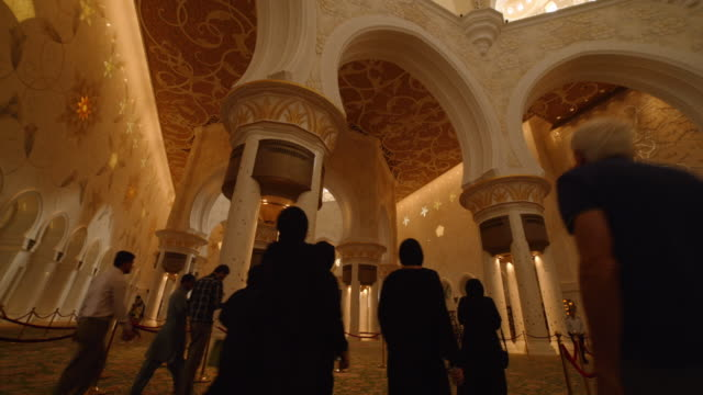 women in burka hijab walk through grand mosque, abu dhabi - mosque stock videos & royalty-free footage