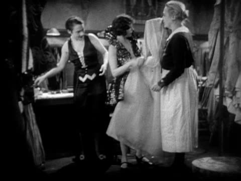 ms, cu, b&w, women in cabaret dressing room, 1920's  - bianco e nero video stock e b–roll