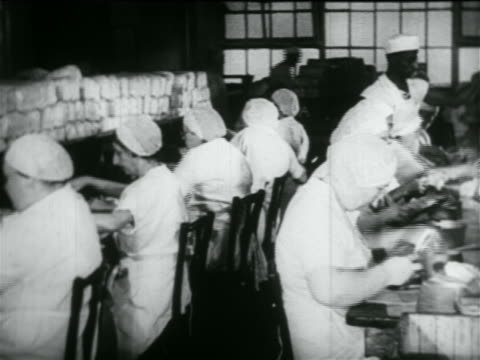 women in caps working in rows in school lunch kitchen in wpa project / documentary - 1934 stock videos & royalty-free footage