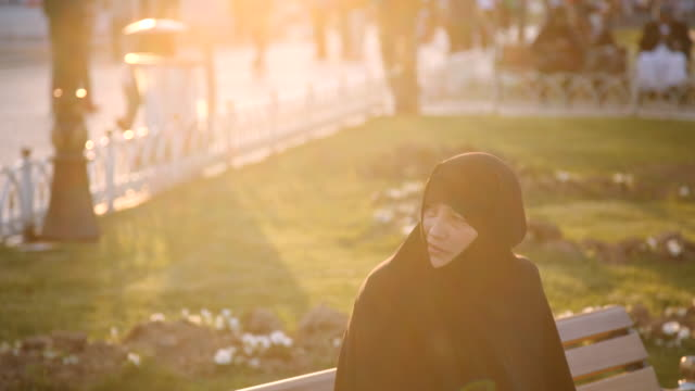 women in conservative dress in sultanahmet park, istanbul, turkey - burka stock videos and b-roll footage