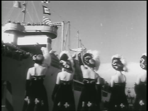 view women in costumes waving to soldiers on military ship / seattle - 1954 stock videos and b-roll footage