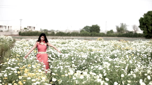Women in flower of field