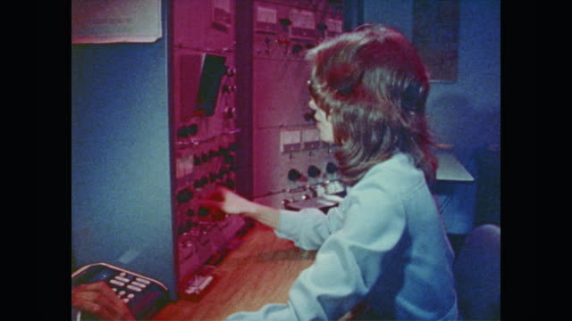 women in glasses working at large computer switchboard - 電話交換機点の映像素材/bロール
