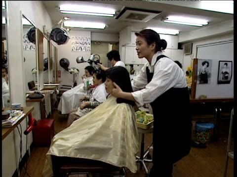 Women in hairdressers' salon Japan
