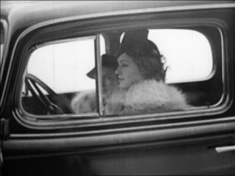 B/W 1933 PAN 2 women in hats driving with windows down + smiling / industrial