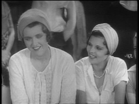 vídeos de stock e filmes b-roll de b/w 1931 2 women in hats talking + smiling / short - 1931