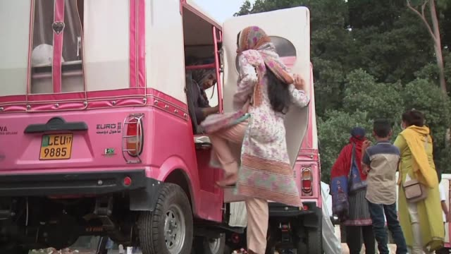 Women in Lahore take part in a rally to celebrate the success of the Pink rickshaw project which allows women to get behind the wheel of three wheel...