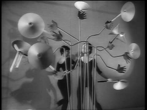 b/w 1964 2 women in leotards dancing around metal sculpture / paris / newsreel - 1964 stock videos & royalty-free footage