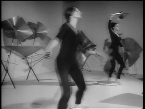 b/w 1964 2 women in leotards dancing with metal sculptures / paris / newsreel - 1964 stock videos and b-roll footage