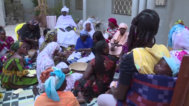 women in senegal use traditional cooperative microcredit schemes to save money and set up small business ventures or new homes - financial accessory stock videos & royalty-free footage