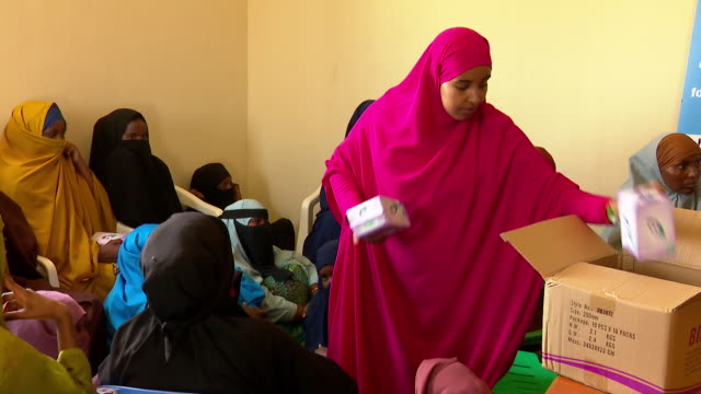 women in somalia being taught about mentstrual hygiene and given sanitary towels - menstruation stock videos & royalty-free footage