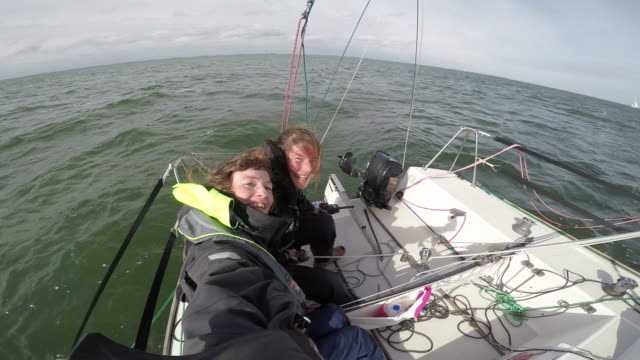 women in sport: female solo sailor with her friend taking a selfie - 50 54 years stock videos & royalty-free footage