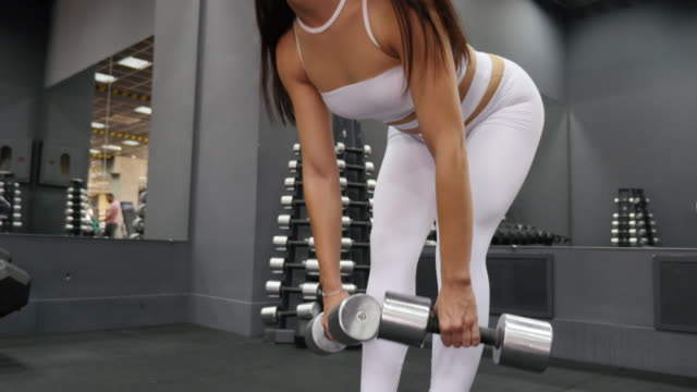 women in sport.  fitness woman training with dumbbells - fitness tracker stock videos and b-roll footage