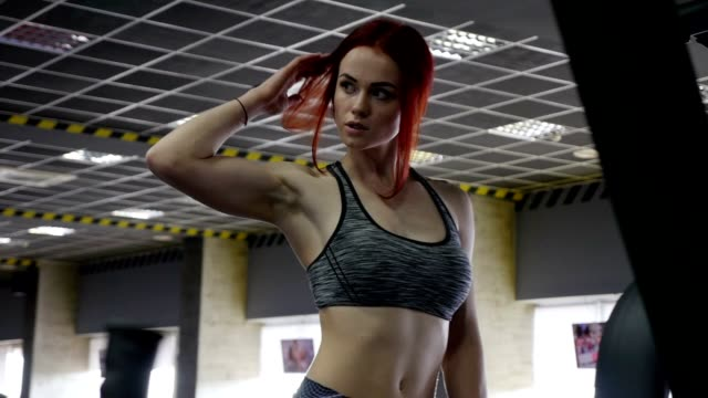 women in sport. redhead fitness woman pulls up on the simulator - fitness tracker stock videos and b-roll footage