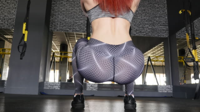 women in sport. redhead fitness woman training with trx fitness straps - studio background stock videos and b-roll footage