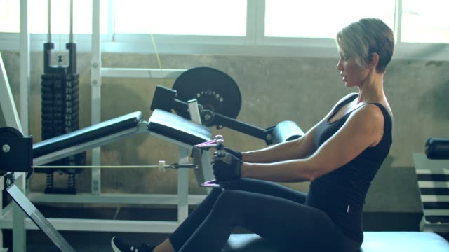 women in sport : woman doing exercises on rowing machine - rowing machine stock videos & royalty-free footage