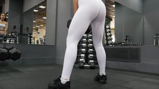 women in sport. young beautiful girl is engaged on a fitness machine in the fitness center - sports target stock videos and b-roll footage