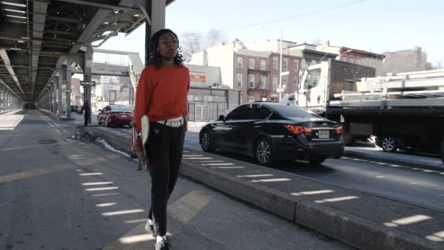 Women in Sport - young, black woman skateboards in Brooklyn, New York City - 4k