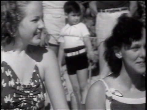 b/w 1937 2 women in swimsuits laughing on beach / florida / newsreel - 1937 stock videos and b-roll footage