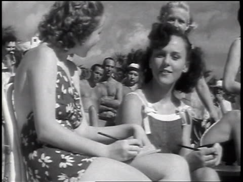 b/w 1937 women in swimsuits writing scores for male lifeguards in beauty contest / florida / news. - beauty pageant stock videos and b-roll footage