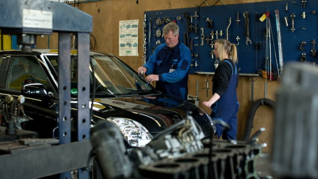 women in technology - a girl as an apprentice in a car repair shop - automobile industry stock videos & royalty-free footage