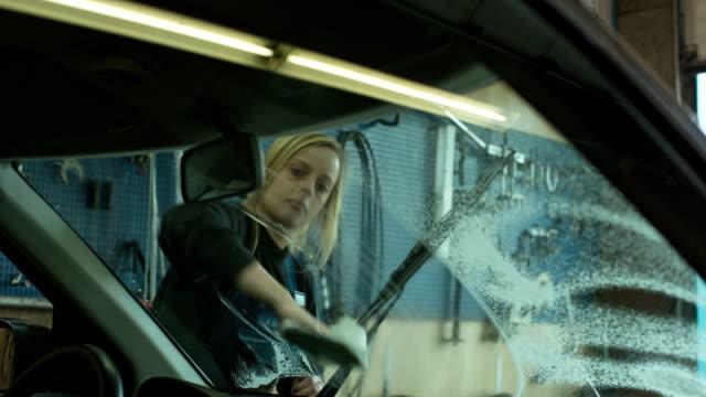 women in technology - a girl as an apprentice in a car repair shop - nordeuropäischer abstammung stock-videos und b-roll-filmmaterial