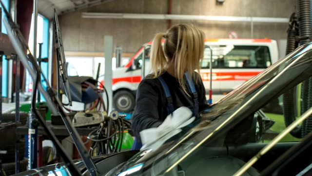 Women in Technology - A girl as an apprentice in a car repair shop