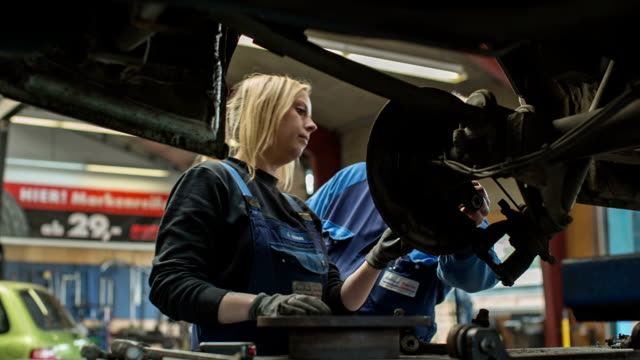 Women in Technology - A girl as an apprentice in a car repair shop