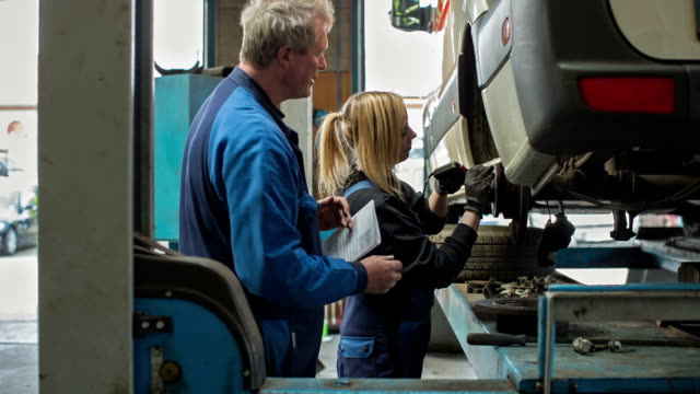women in technology - a girl as an apprentice in a car repair shop - equality stock videos & royalty-free footage