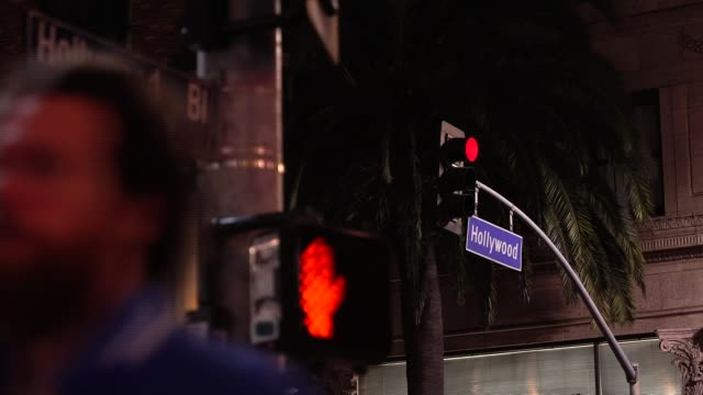 vidéos et rushes de women in the entertainment industry talks of their experiences following the allegations made against harvey weinstein; people along street as busker... - street name sign